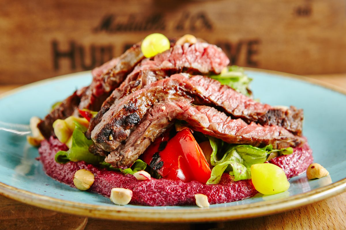 Salad with Grilled Prime Beef or Thick Slices of Marbling Steak on Blue Plate
