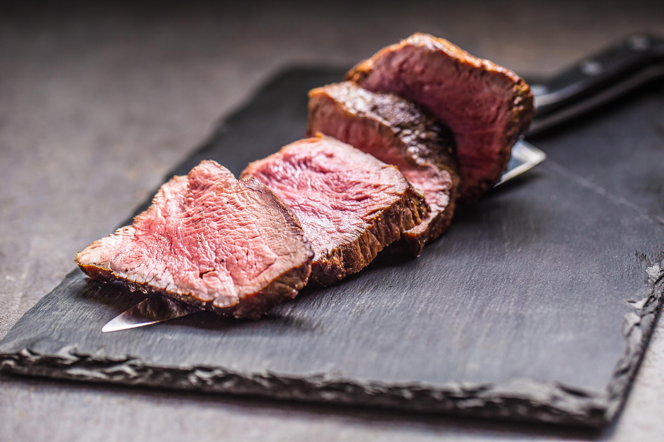 Bone In Rib Eye row Steak and knife